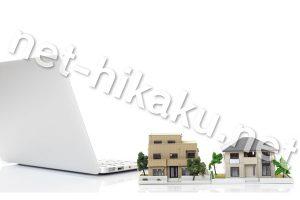 パソコンと住宅街の模型